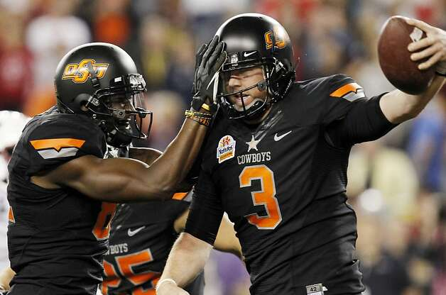 Oklahoma State's Brandon Weeden (3) celebrates his touchdown against Stanford with teammate Justin Blackmon during the first half of the Fiesta Bowl NCAA college football game Monday, Jan. 2, 2012, in Glendale, Ariz.(AP Photo/Ross D. Franklin) Photo: Ross D. Franklin, Associated Press
