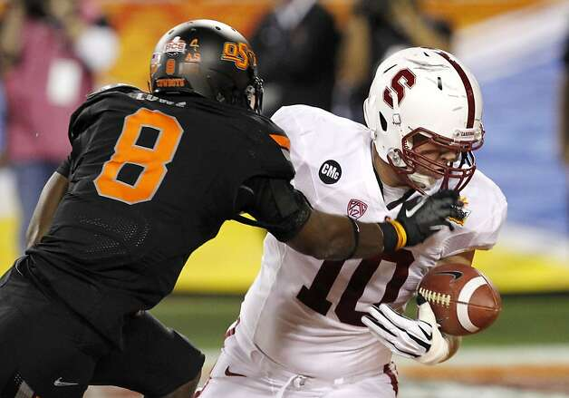 Oklahoma State's Daytawion Lowe (8) tips the ball away from Stanford's Geoff Meinken (10) in the end zone during the first half of the Fiesta Bowl NCAA college football game Monday, Jan. 2, 2012, in Glendale, Ariz.(AP Photo/Ross D. Franklin) Photo: Ross D. Franklin, Associated Press