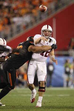 GLENDALE, AZ - JANUARY 02:  Andrew Luck #12 of the Stanford Cardinal throws a pass under pressure in the second half against the Oklahoma State Cowboys during the Tostitos Fiesta Bowl on January 2, 2012 at University of Phoenix Stadium in Glendale, Arizona.  (Photo by Christian Petersen/Getty Images) Photo: Christian Petersen, Getty Images