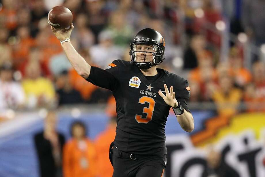 Brandon Weeden of the Oklahoma State Cowboys throws a pass against the Stanford Cardinal during the Fiesta Bowl on Jan. 2, 2012 at University of Phoenix Stadium in Glendale, Ariz. Photo: Christian Petersen, Getty Images