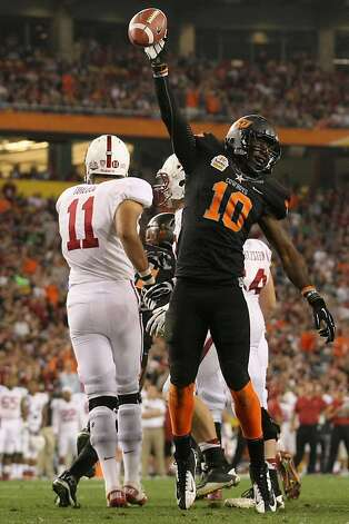 GLENDALE, AZ - JANUARY 02:  Markelle Martin #10 of the Oklahoma State Cowboys celebrates after he recovered a fumble by Stanford Cardinal in the third quarter during the Tostitos Fiesta Bowl on January 2, 2012 at University of Phoenix Stadium in Glendale, Arizona.  (Photo by Donald Miralle/Getty Images) Photo: Donald Miralle, Getty Images