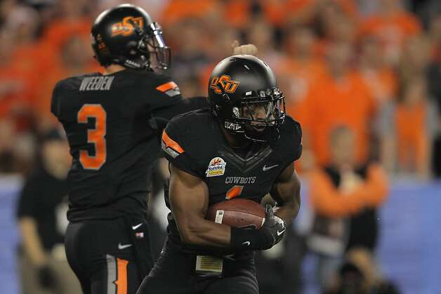 GLENDALE, AZ - JANUARY 02:  Joseph Randle #1 of the Oklahoma State Cowboys runs the ball against the Stanford Cardinal during the Tostitos Fiesta Bowl on January 2, 2012 at University of Phoenix Stadium in Glendale, Arizona.  (Photo by Doug Pensinger/Getty Images) Photo: Doug Pensinger, Getty Images