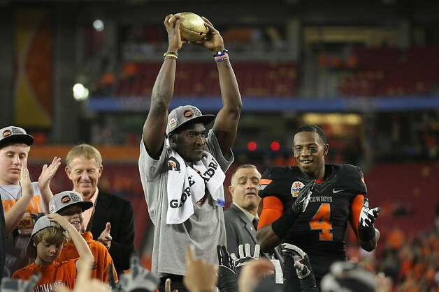 GLENDALE, AZ - JANUARY 02:  Justin Blackmon #81 of the Oklahoma State Cowboys celebrates with the trophy after after Oklahoma won 41-38 in overtime against the Stanford Cardinal during the Tostitos Fiesta Bowl on January 2, 2012 at University of Phoenix Stadium in Glendale, Arizona.  (Photo by Donald Miralle/Getty Images) Photo: Donald Miralle, Getty Images