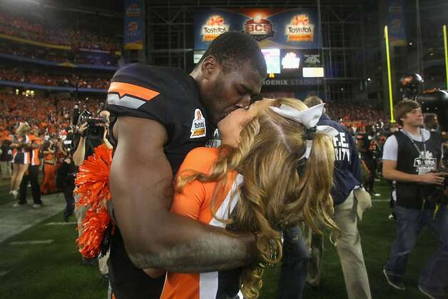 GLENDALE, AZ - JANUARY 02:  Justin Blackmon #81 of the Oklahoma State Cowboys celebrates with a cheerleader after Oklahoma State Cowboys won 41-38 in overtime against the Stanford Cardinal during the Tostitos Fiesta Bowl on January 2, 2012 at University of Phoenix Stadium in Glendale, Arizona.  (Photo by Donald Miralle/Getty Images) Photo: Donald Miralle, Getty Images