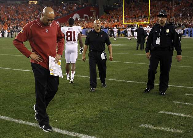 Stanford head coach David Shaw walks off the field as the Cardinal loses to Oklahoma State Cowboys 41-38 in overtime of the Fiesta Bowl game in Glendale, Ariz. on Monday, Jan. 2, 2012. Photo: Paul Chinn, The Chronicle