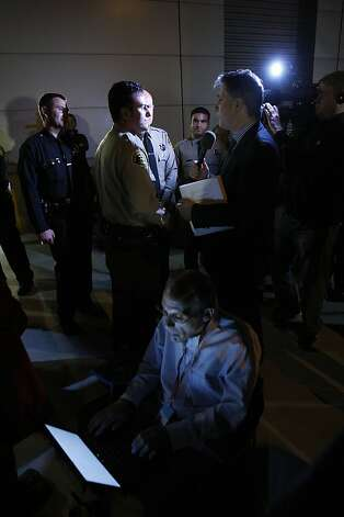 LOS ANGELES, CA - JANUARY 2:  A reporter talks to Los Angeles County Reserve Deputy Sheriff Shervin Lalezary, who is credited with being the officer who arrested a serial arson suspect, on January 2, 2012 in Los Angeles, California. The mayor identified Harry Burkhart, 24, as the suspect in custody whom police say was likely  responsible for setting more than 50 fires over the weekend.  (Photo by David McNew/Getty Images) Photo: David McNew, Getty Images