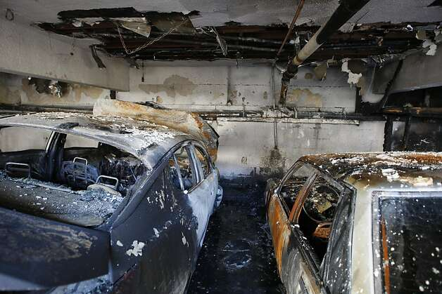 LOS ANGELES, CA - JANUARY 2:  Cars that were burned in a spree of arson fires lie in ruins on January 2, 2012 in Los Angeles, California. Police have taken a suspect into custody whom they believe was responsible for setting more than 50 fires over the weekend.  (Photo by David McNew/Getty Images) Photo: David McNew, Getty Images
