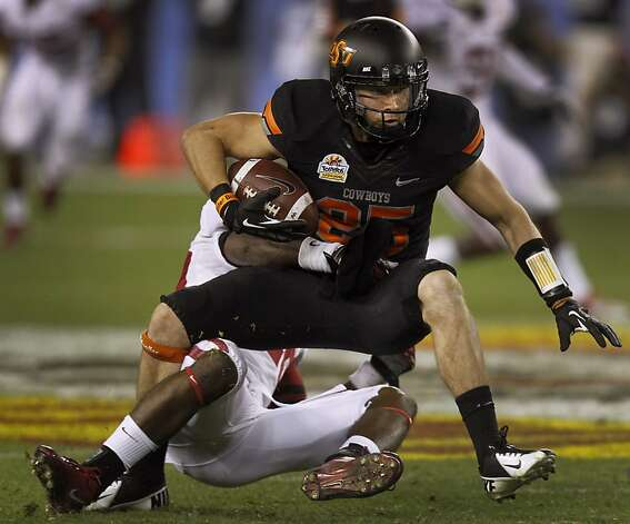 Oklahoma State Cowboys receiver Josh Cooper picks up a first down against the Stanford Cardinal in the third quarter at the Fiesta Bowl game in Glendale, Ariz. on Monday, Jan. 2, 2012. Photo: Paul Chinn, The Chronicle