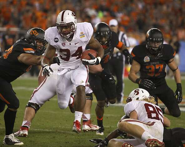 Stanford running back Jeremy Stewart rushes through the Oklahoma State defense in the third quarter of the Fiesta Bowl game in Glendale, Ariz. on Monday, Jan. 2, 2012. Photo: Paul Chinn, The Chronicle