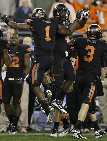 Oklahoma State's Joseph Randle (1) jumps for joy after scoring the game-tying touchdown late in the fourth quarter against the Stanford Cardinal at the Fiesta Bowl game in Glendale, Ariz. on Monday, Jan. 2, 2012. Photo: Paul Chinn, The Chronicle