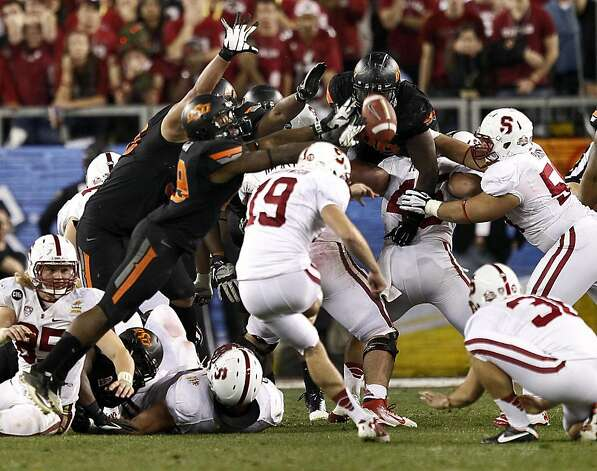 Stanford kicker Jordan Williamson (19) kicks and misses a field goal attempt in overtime during the Fiesta Bowl NCAA college football game against Oklahoma State Monday, Jan. 2, 2012, in Glendale, Ariz. Oklahoma State won 41-38 in overtime. (AP Photo/Matt York) Photo: Matt York, Associated Press