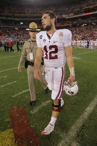 GLENDALE, AZ - JANUARY 02:  Andrew Luck #12 of the Stanford Cardinal walks off of the field after Stanford lost 41-38 in overtime against the Oklahoma State Cowboys during the Tostitos Fiesta Bowl on January 2, 2012 at University of Phoenix Stadium in Glendale, Arizona.  (Photo by Doug Pensinger/Getty Images) Photo: Doug Pensinger, Getty Images