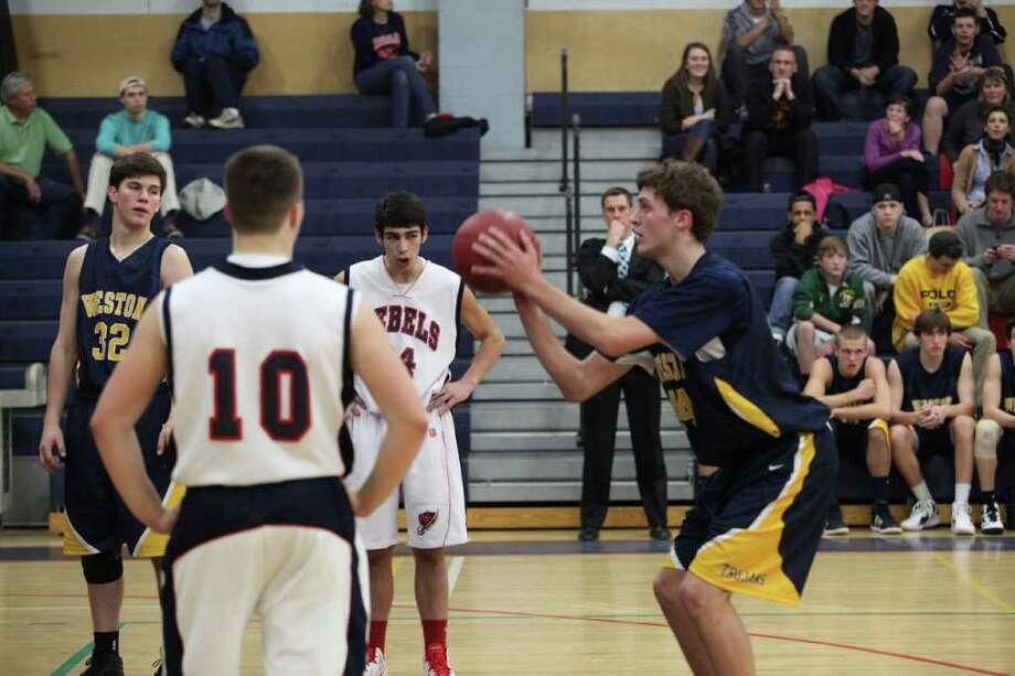 Weston's Lyle Mitchell prepares to shoot a free throw Dec. 23 against New Fairfield. Mitchell had 10 points Thursday in a 65-41 loss to Ridgefield in the Ridgefield Holiday Tournament championship game. Mitchell was named to the All-Tournament team. Photo: Vivian Simons / Contributed Phot