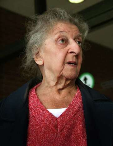 Marion Perreira, 90 of Stratford, exits Bridgeport Superior Court on Tuesday, January 3, 2012. Perreira is being sued by Stratford over custody and care of cats that have been removed from Perreira's home since July 2010. Photo: Brian A. Pounds / Connecticut Post