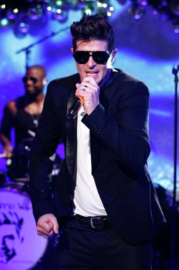 """Best CollaborationJustin Timberlake, feat. Jay-Z, """"Suit & Tie"""" Pitbull feat. Christina Aguilera, """"Feel This Moment"""" Calvin Harris feat. Ellie Goulding, """"I Need Your Love"""" Robin Thicke (pictured) feat. T.I. and Pharrell, """"Blurred Lines"""" Pink feat. Nate Ruess, """"Just Give Me A Reason"""" Photo: NBC / © NBCUniversal, Inc."""