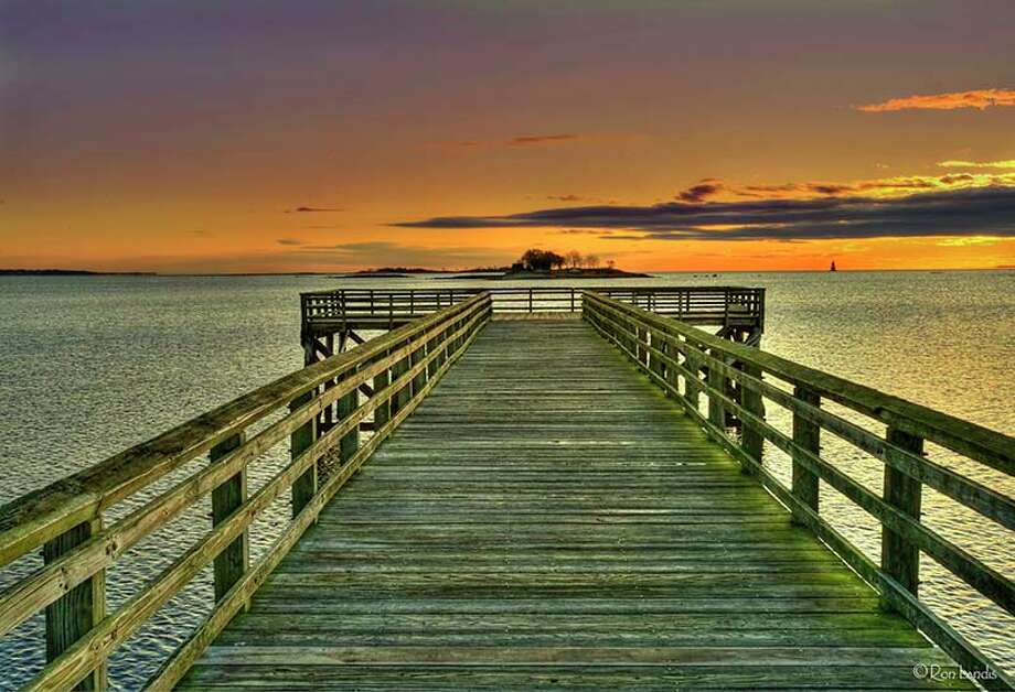 """""""Calf Pasture Pier at Sunrise"""" by Westport photographer Ron Landis is on view in """"Treasures,"""" a new exhibition hosted by the River Road Gallery at the Wilton Library through Jan. 27. Photo: Contributed Photo"""