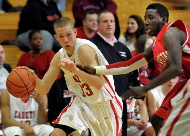 Albany Academy's Matt LaClair (33) moves the past Schenectady's Eddie Stanley (11) during their basketball game at Siena College in Loudonville,N.Y., on Sunday, Jan. 30, 2011. Stanley, 15, was shot and killed early Sunday, June 12, 2011, in Schenectady. (Times Union archive) Photo: Hans Pennink / 00011902A