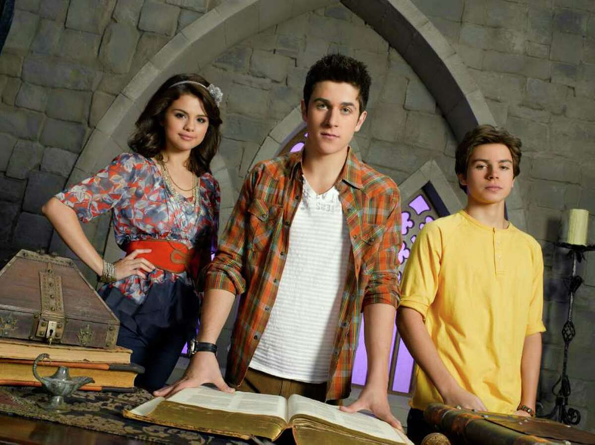 """WIZARDS OF WAVERLY PLACE - Disney Channel's """"Wizards of Waverly Place"""" stars Selena Gomez as Alex Russo, David Henrie as Justin Russo and Jake T. Austin as Max Russo."""