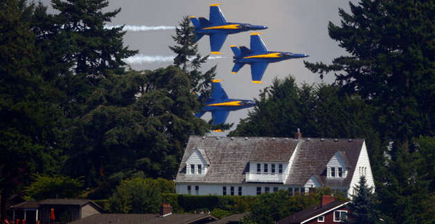 The Blue Angels seem to fly over a house in this photo.