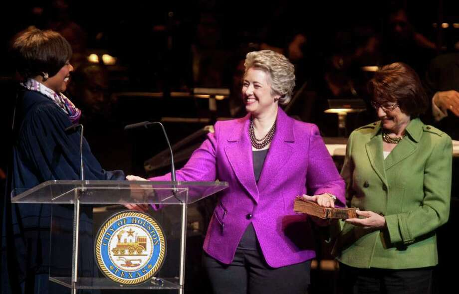 U.S. District Judge Vanessa Gilmore, left swears in Annise Parker, center,  for her second term as the Mayor of Houston during the 2012 City of Houston Inaugural Ceremony in the Hobby Center for the Performing Arts Tuesday, Jan. 3, 2012, in Houston. Parkers partner Kathy Hubbard held the bible for the ceremony. Photo: Nick De La Torre, Houston Chronicle / © 2012  Houston Chronicle