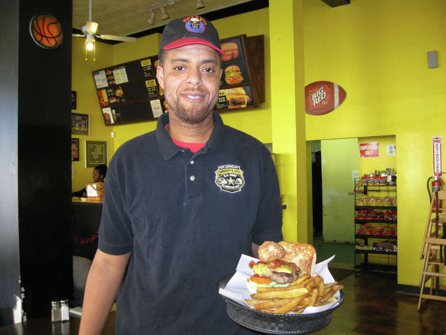 "Fatty's Burgers & More owner Mark Outing has added the ""Ice Cream Cheeseburger"" to his menu. Photo: Marissa Villa / Staff"