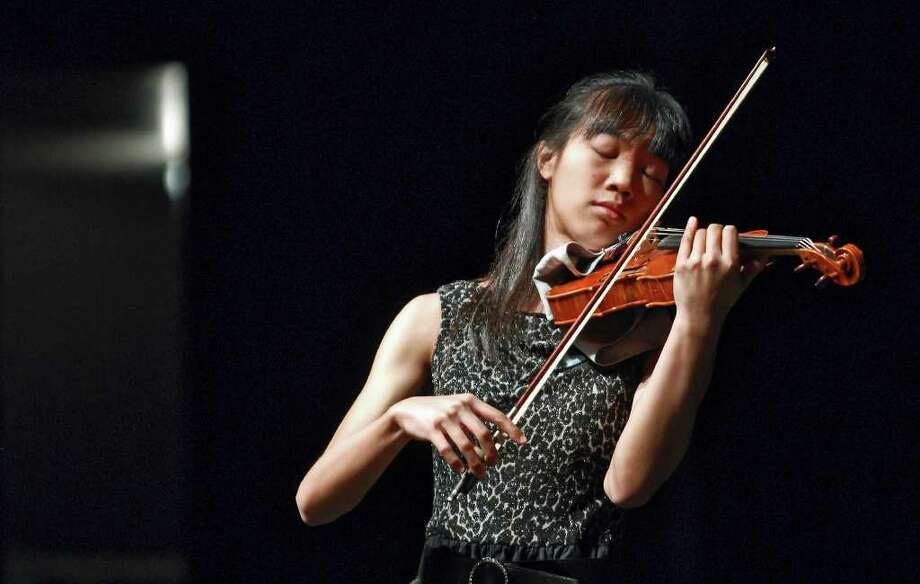 Harvard freshman Nancy Zhou, shown in a past performance in Laredo, exhibits self-assurance and mastery in two technically demanding pieces Friday. Photo: Ulysses S. Romero / Laredo Morning Times