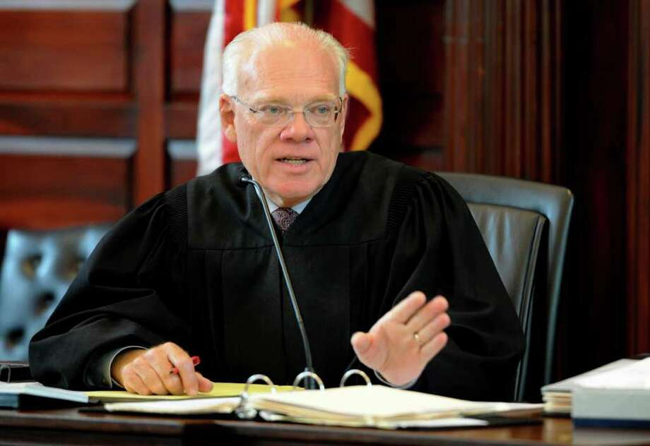 Judge Robert Jacon charges the jury prior to opening statements in the Rensselaer County Courthouse in Troy, N.Y. during Michael Mosley's murder trial May 9, 2011.    (Skip Dickstein / Times Union) Photo: SKIP DICKSTEIN / 00013077A