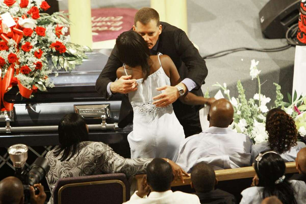 UConn football coach Randy Edsall hugs JoAngila Howard during the funeral for her son, Jasper Howard, Monday, Oct. 26, 2009 in Miami. Howard, a UConn football player, was fatally stabbed outside a dance on Connecticut's campus. (AP Photo/J Pat Carter)