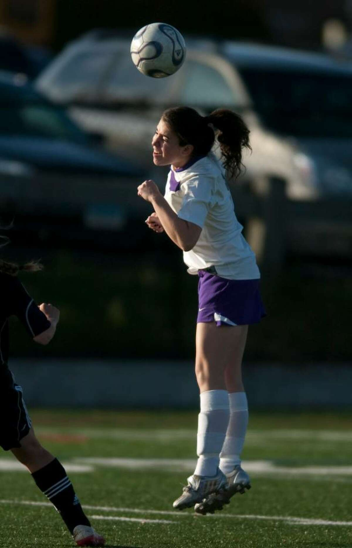 Westhill's Sarah Hartford heads the ball during an FCIAC soccer game against Fairfield Warde High School at Westhill High School in Stamford, Conn. on Monday, Oct. 26, 2009.