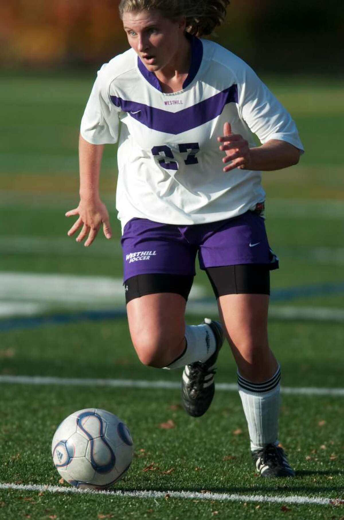 Westhill's Claire Mahoney heads down field during an FCIAC soccer game against Fairfield Warde High School at Westhill High School in Stamford, Conn. on Monday, Oct. 26, 2009.