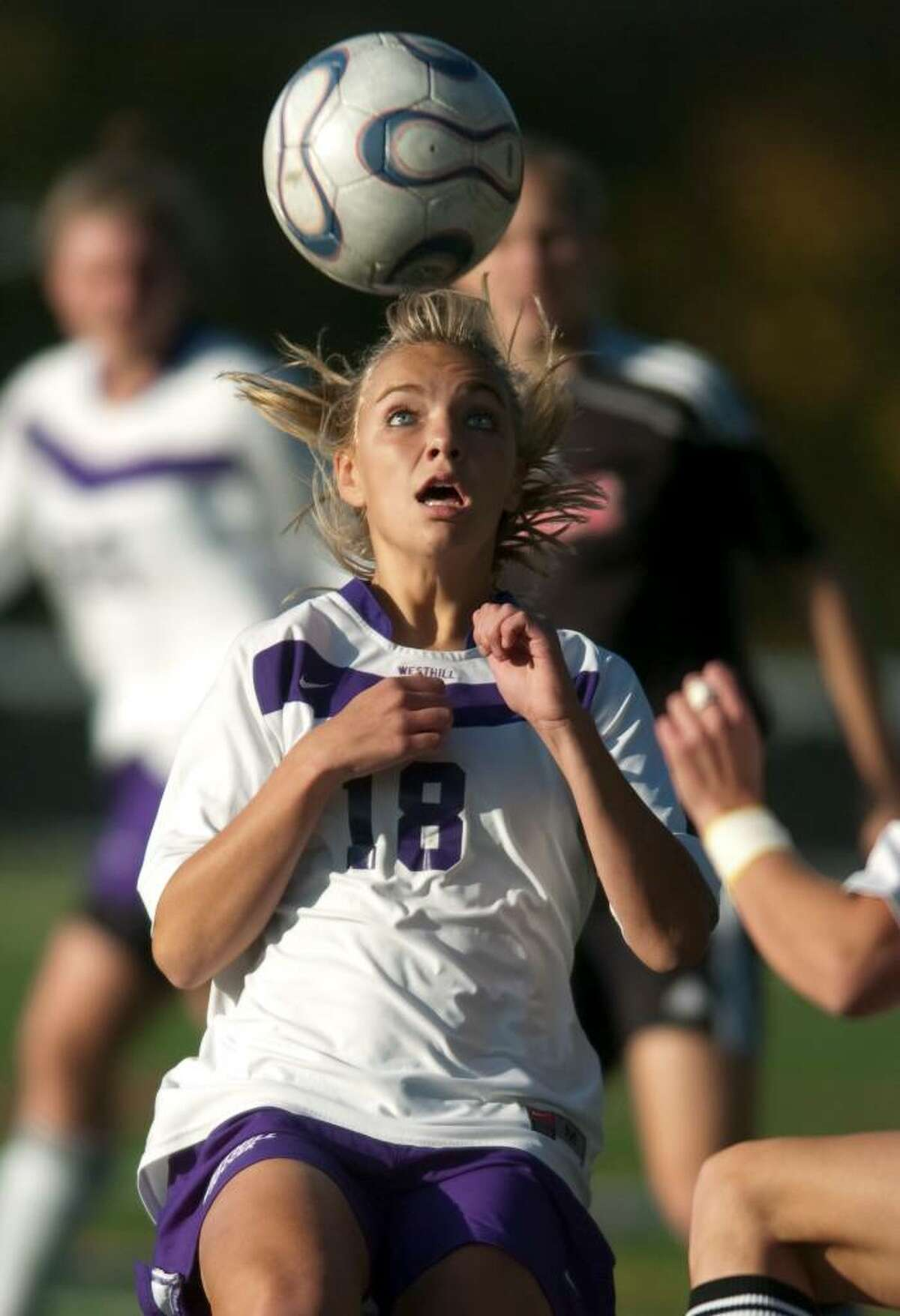 Nicole Eriksen keeps her eye on the ball during an FCIAC soccer game against Fairfield Warde High School at Westhill High School in Stamford, Conn. on Monday, Oct. 26, 2009.