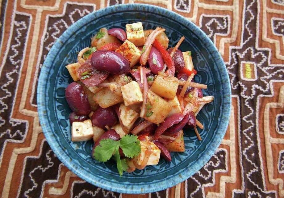 Peruvian olive salad combines boiled potatoes and slivered red onions in a zingy vinaigrette. (Maricel Presilla/Miami Herald/MCT) Photo: Maricel Presilla / Miami Herald