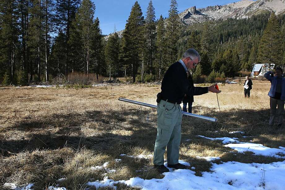 Chief of the California Cooperative Snow Survey Frank Gehrke measuring 400 feet from the marker pole to do a manual survey off Highway 50 at Philllips Station near Echo Summit, Calif., on Tuesday, January 3, 2012.   This and other manual and electronic surveys up and down the state will determine the amount of water in the early winter snowpack. Photo: Liz Hafalia, The Chronicle