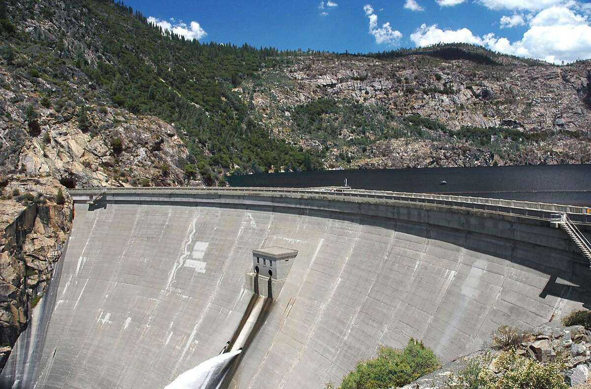 ** FILE ** This is a June 2004 file photo of O'Shaughnessy Dam in the Hetch Hetchy reservoir in Yosemite National Park, Calif. Of all the battles over natural resources in California, there have perhaps been none more quixotic than the effort by a small but growing number of environmentalists to tear down the dam in Yosemite National Park that for 80 years has provided power and drinking water to much of Northern California. A new report released Monday, Sept. 27, 2004, by Environmental Defense is thelatest attempt to sway public opinion in favor of draining Hetch Hetchy Valley, and restoring to nature what conservationist John Muir called Yosemite Valley's twin brother. (AP Photo/Environmental Defense, Tim Connor)