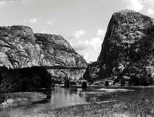 "The Hetch Hetchy Valley in Yosemite National Park, Calif., is seen in this undated photo provided by the The Bancroft Library at the University of California in Berkeley. With its soaring granite cliffs and spouting waterfalls, Yosemite's Hetch Hetchy Valley was described by conservationist John Muir as ""one of Nature's rarest and most precious mountain temples."" But much of the valley now lies submerged under 300 feet of water, after it was dammed and flooded more than 80 years ago to supply drinking water and hydropower to the San Francisco Bay area. (AP Photo/University of California, Berkeley) Photo: University Of California, Associated Press"