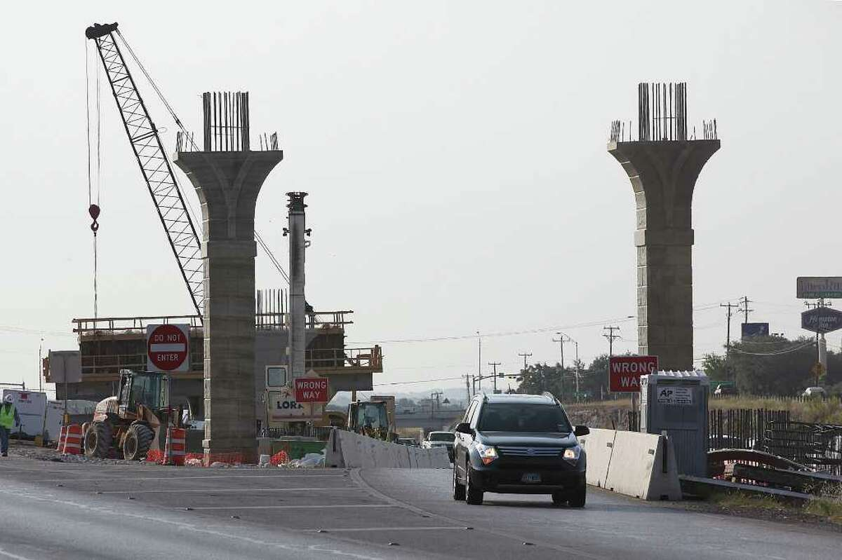 Traffic moves along the construction at the U.S. 281 and Loop 1604 interchange site last summer. Just the southern connectors cost $130 million; a projected local TxDOT windfall of $200 million won't go far.