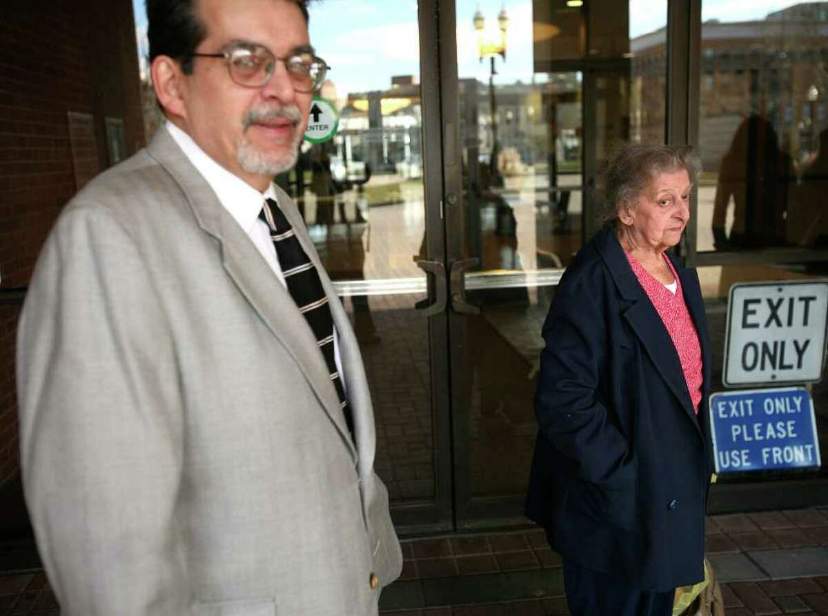 Marion Perreira, right, 90 of Stratford, and her son William, 56, exit Bridgeport Superior Court on Tuesday, January 3, 2012. Perreira is being sued by Stratford over custody and care of cats that have been removed from Perreira's home since July 2010. Following the hearing, William Perreira was arrested by Stratford Police on three counts of animal cruelty.
