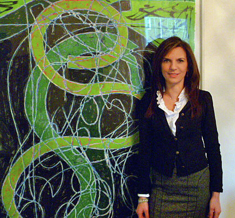 Susan Gilgore has been named executive director of the Lockwood-Mathews Mansion Museum in Norwalk, effective Jan. 1. She is depicted here in her home in front of a Frank Stella print. Her dad represented Stella at his NYC gallery  when she was a little girl, and he gave it to her as a present when she moved to New York. Photo: Contributed Photo