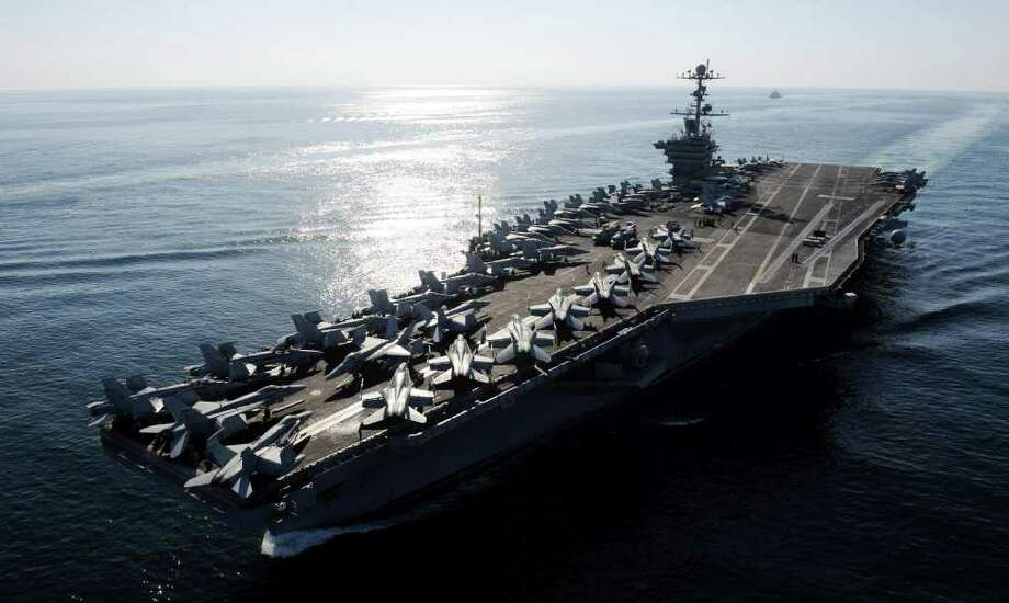 In this Nov. 12, 2011photo provided by the U.S. Navy, the Nimitz-class aircraft carrier USS John C. Stennis (CVN 74) transits the Straits of Hormuz. The Pentagon on Tuesday, Jan. 3, 2012 answered an Iranian warning to keep U.S. aircraft carriers out of the Persian Gulf by declaring that American warships will continue regularly scheduled deployments to the strategic waterway. The Navy has said the Stennis and another vessel exited the Gulf through the Strait of Hormuz a week ago, after operating in the area. (AP Photo/U.S. Navy, Petty Officer 3rd Class Kenneth Abbate) Photo: MC3 Kenneth Abbate