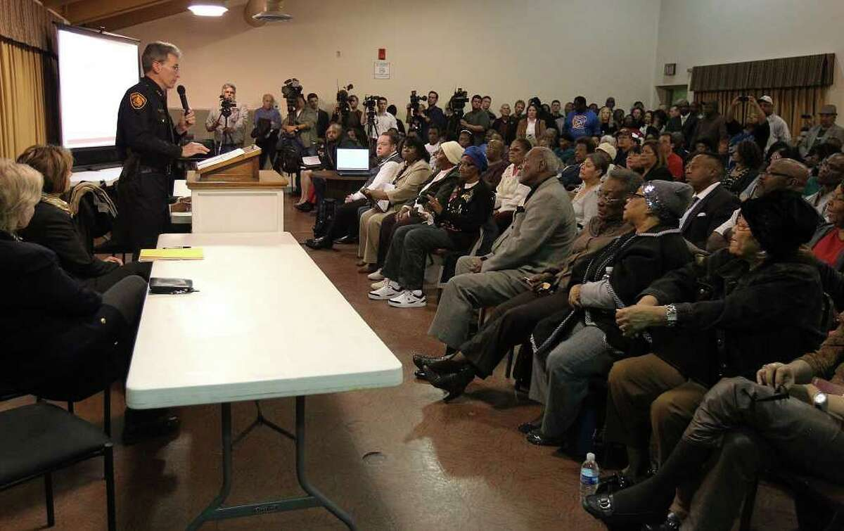 Police Chief William McManus (left) addresses a packed room of citizens as city officials hold a meeting with residents of the Eastside at Barbara Jordan Community Center on Tuesday, Jan. 3, 2012. A recent spate of drive-by shootings have raised concerns in the community. Kin Man Hui/kmhui@express-news.net