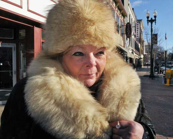 Bundled up in fur agaist today's bitter cold, Deborah Ritter of Schenectady runs errands in downtown Schenectady Tuesday Jan. 3, 2012.   (John Carl D'Annibale / Times Union) Photo: John Carl D'Annibale / 10015976A