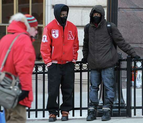 A couple young men try to stay warm on a frigid winter day moments before boarding a CDTA bus Tuesday, Jan. 3, 2012 in Albany, N.Y. (Lori Van Buren / Times Union) Photo: Lori Van Buren