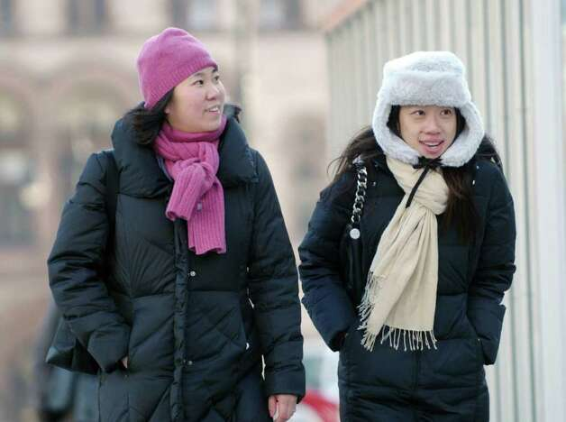 Assemblywoman Grace Meng, left, from Flushing, Queens and Sandra Ung, also from Flushing Queens, make their way up Washington Ave. in the cold temperatures on Tuesday, Jan. 3, 2012 in Albany.  (Paul Buckowski / Times Union) Photo: Paul Buckowski