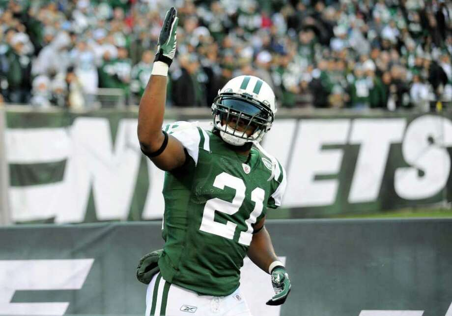 "FILE - In this Dec. 11, 2011, file photo, New York Jets' LaDainian Tomlinson gestures to the fans before the NFL football game between the Kansas City Chiefs and the Jets in East Rutherford, N.J. Jets running back LaDainian Tomlinson says their game scheduled for Sunday, Jan. 1 at Miami could possibly be the last of his career if New York does not make the playoffs. Tomlinson, set to become a free agent, says Thursday, Dec. 29 that he will ""wait and see"" before deciding on whether to continue playing beyond this season, adding that he'll retire if the situation isn't right. (AP Photo/Bill Kostroun, File) Photo: Bill Kostroun"