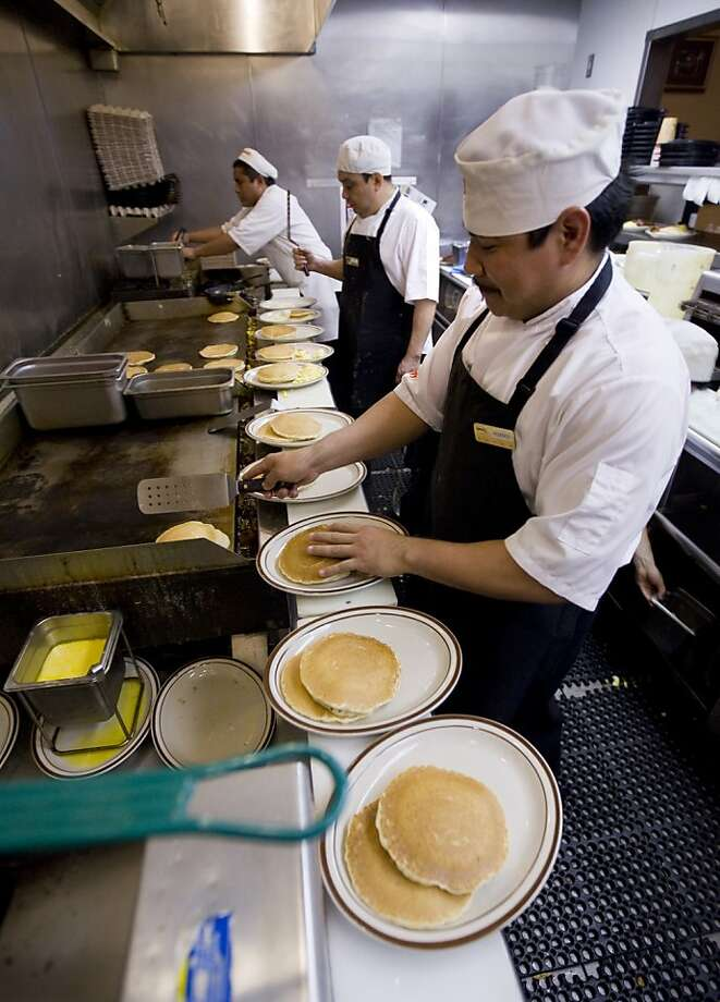 Federico Pech plates Grand Slam breakfasts at the Denny's on Mission Street in 2009. Photo: Kim Komenich, The Chronicle