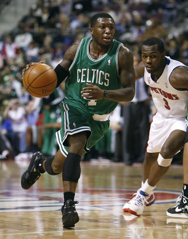Boston Celtics guard Nate Robinson (4) drives around Detroit Pistons guard Rodney Stuckey (3) during the fourth quarter of an NBA basketball game in Auburn Hills, Mich., Tuesday, March 2, 2010. Robinson scored 14 points in 16 minutes as the Celtics defeated the Pistons 105-100. Photo: Carlos Osorio, AP