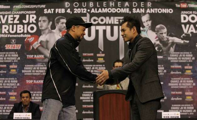 "Boxers Wilfredo Vazquez, Jr. (left) and Nonito Donaire (right) shake hands Tuesday, Jan. 3, 2012 during a press conference at the Alamodome announcing the doubleheader ""Welcome to the Future"" boxing card. The two matches will feature a bout between Vazquez and Nonaire for the World Jr. Featherweight Championship and a bout between Julio Cesar Chavez Jr. and Marco Antonio Rubio for the World Middleweight Championship. Photo: JOHN DAVENPORT, SAN ANTONIO EXPRESS-NEWS"