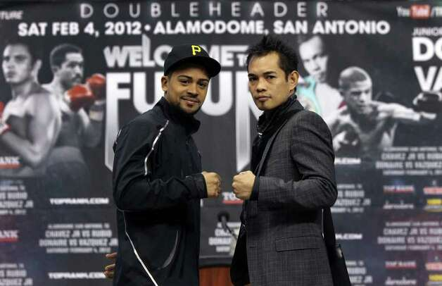 "Wilfredo Vazquez, Jr. (left) and Nonito Donaire (right) pose for the media and people gathered at the Alamodome Tuesday, Jan. 3, 2012 during a press conference announcing a doubleheader of boxing matches called ""Welcome to the Future."" The fights, to be held Feb. 4 at the Alamodome, will feature a match pitting Vazquez against Donaire for the World Jr. Featherweight Championship and Julio Cesar Chavez Jr. against Marco Antonio Rubio for the World Middleweight Championship title. Photo: JOHN DAVENPORT, SAN ANTONIO EXPRESS-NEWS"