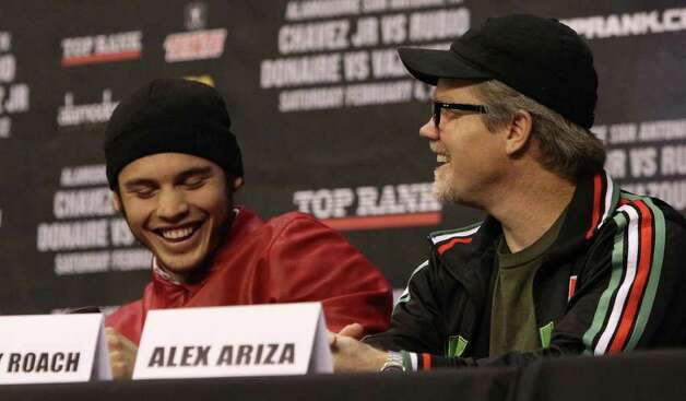"Boxer Julio Cesar Chavez Jr. (left) laughs with his trainer Freddie Roach (right) during a press conference Tuesday, Jan. 3, 2012 at the Alamodome. Boxing promoters announced the ""Welcome to the Future"" boxing card to be held at the Alamodome Saturday Feb. 4. The card will feature a match between Chavez and Marco Antonio Rubio for the World Middleweight Championship and a match between Nonito Donaire and Wilfredo Vazquez Jr. for the World Jr. Featherweight Championship. Photo: JOHN DAVENPORT, SAN ANTONIO EXPRESS-NEWS  / SAN ANTONIO EXPRESS-NEWS (Photo can be sold to the public)"