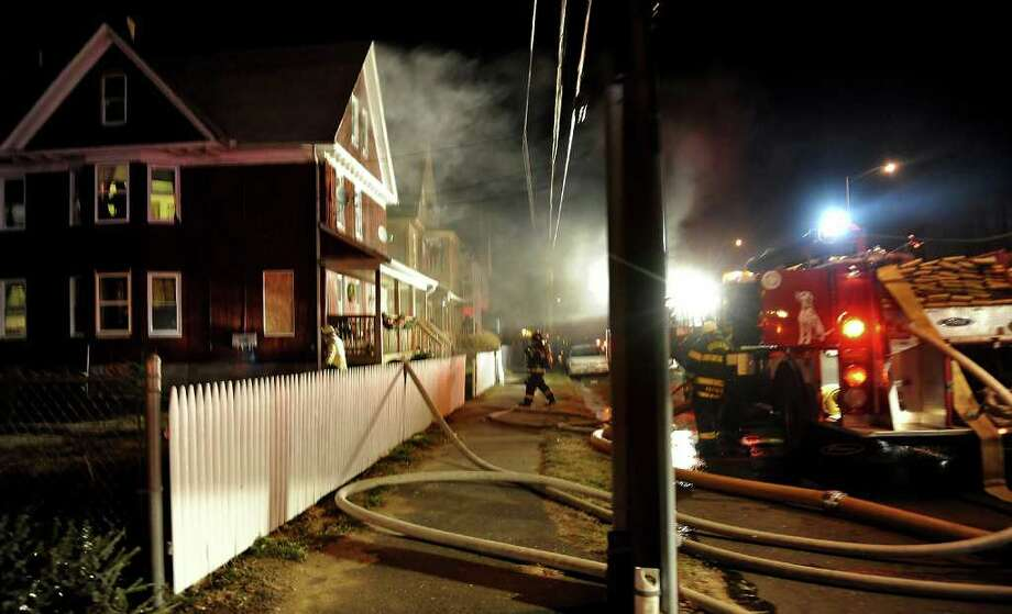 Bridgeport Fire Department was called out to battle a structure fire in frigid temperatures on Orange Street in Bridgeport, Conn. on Tuesday January 3, 2012. The fire displaced six people. Photo: Christian Abraham / Connecticut Post
